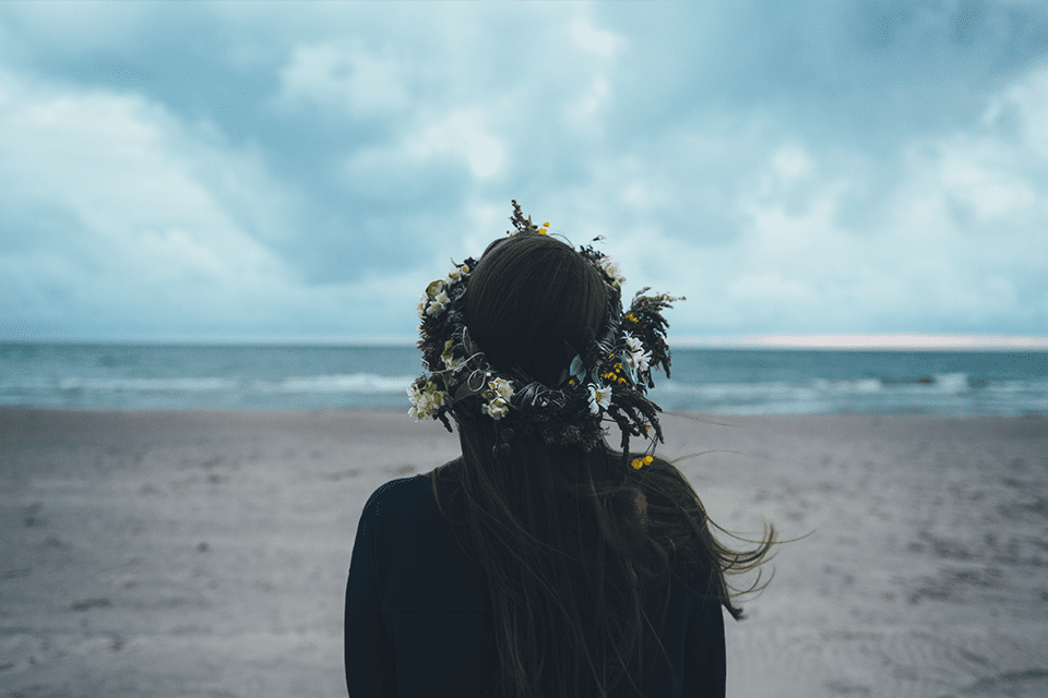 lady wearing flower crown on beach
