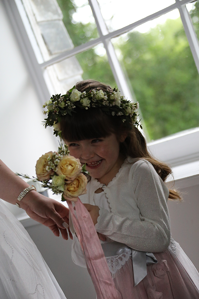 Bridesmaid with flower wand and garland