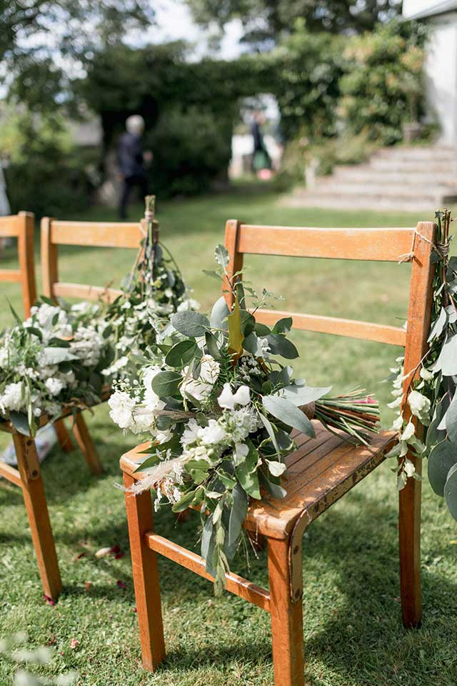 wedding flowers on wooden chair