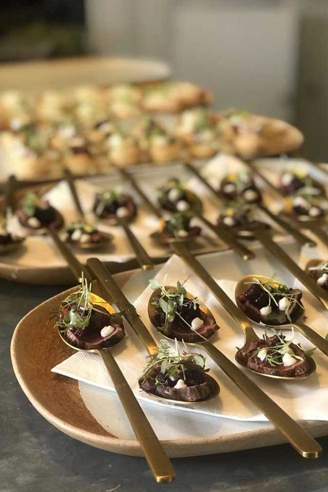 fine dining wedding canapes served on gold spoons