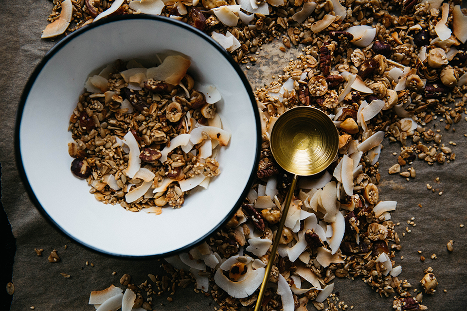 Homemade breakfast granola in white bowl on table
