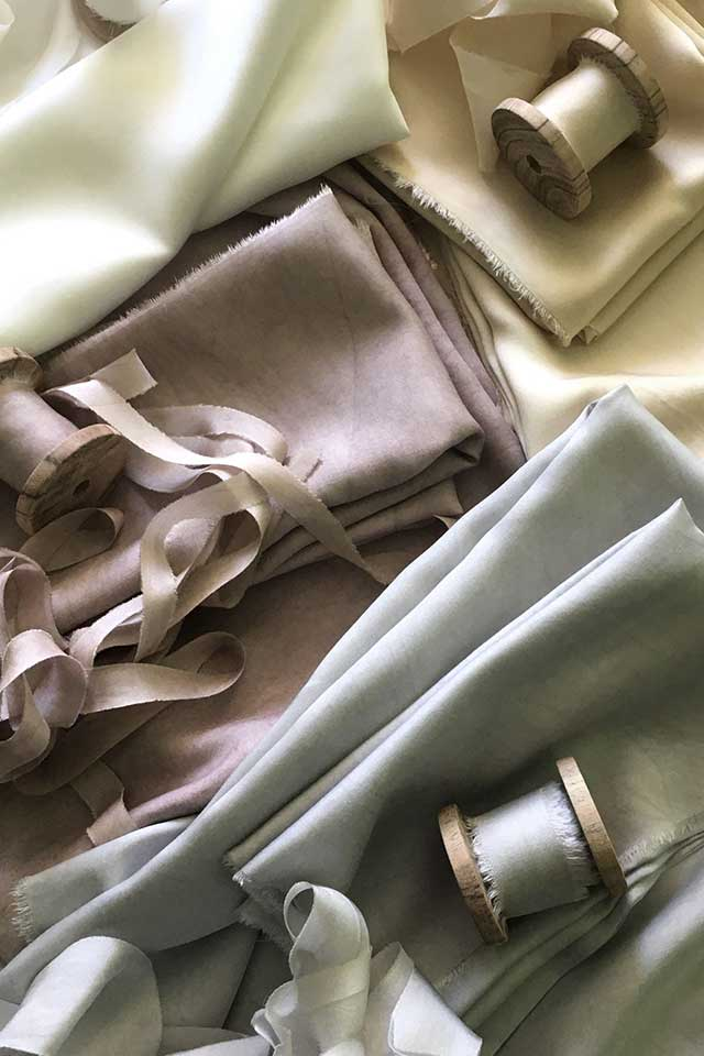pile of delicate hand dyed silks by Lancaster and Cornish