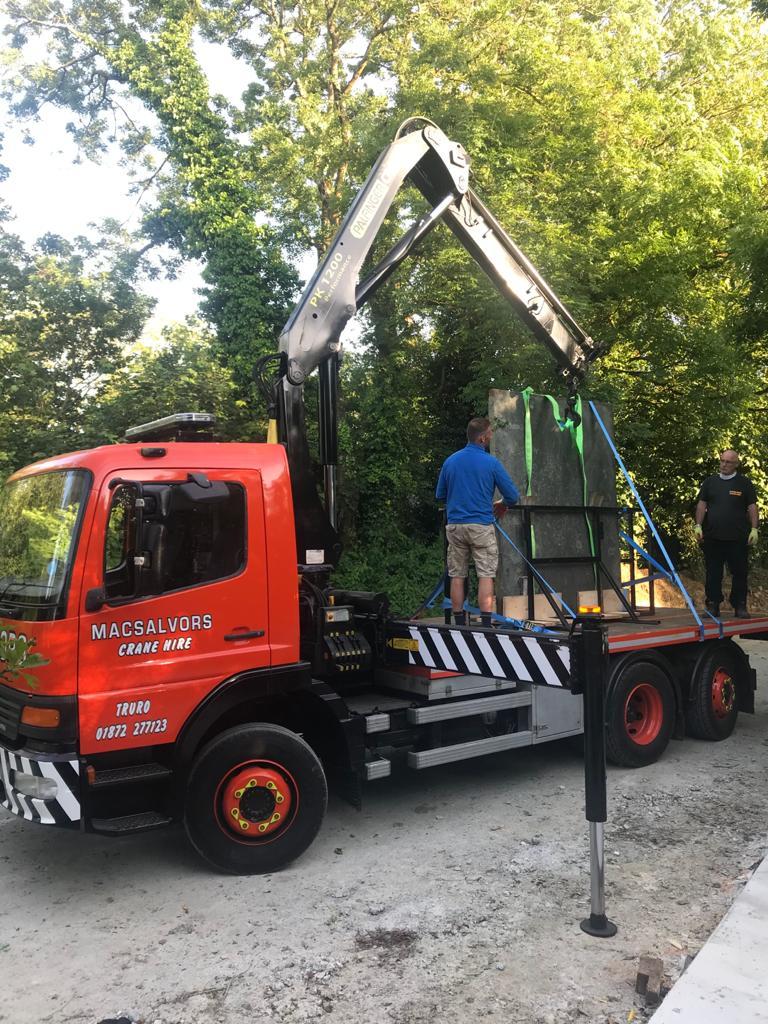 crane delivering slate for sculpting