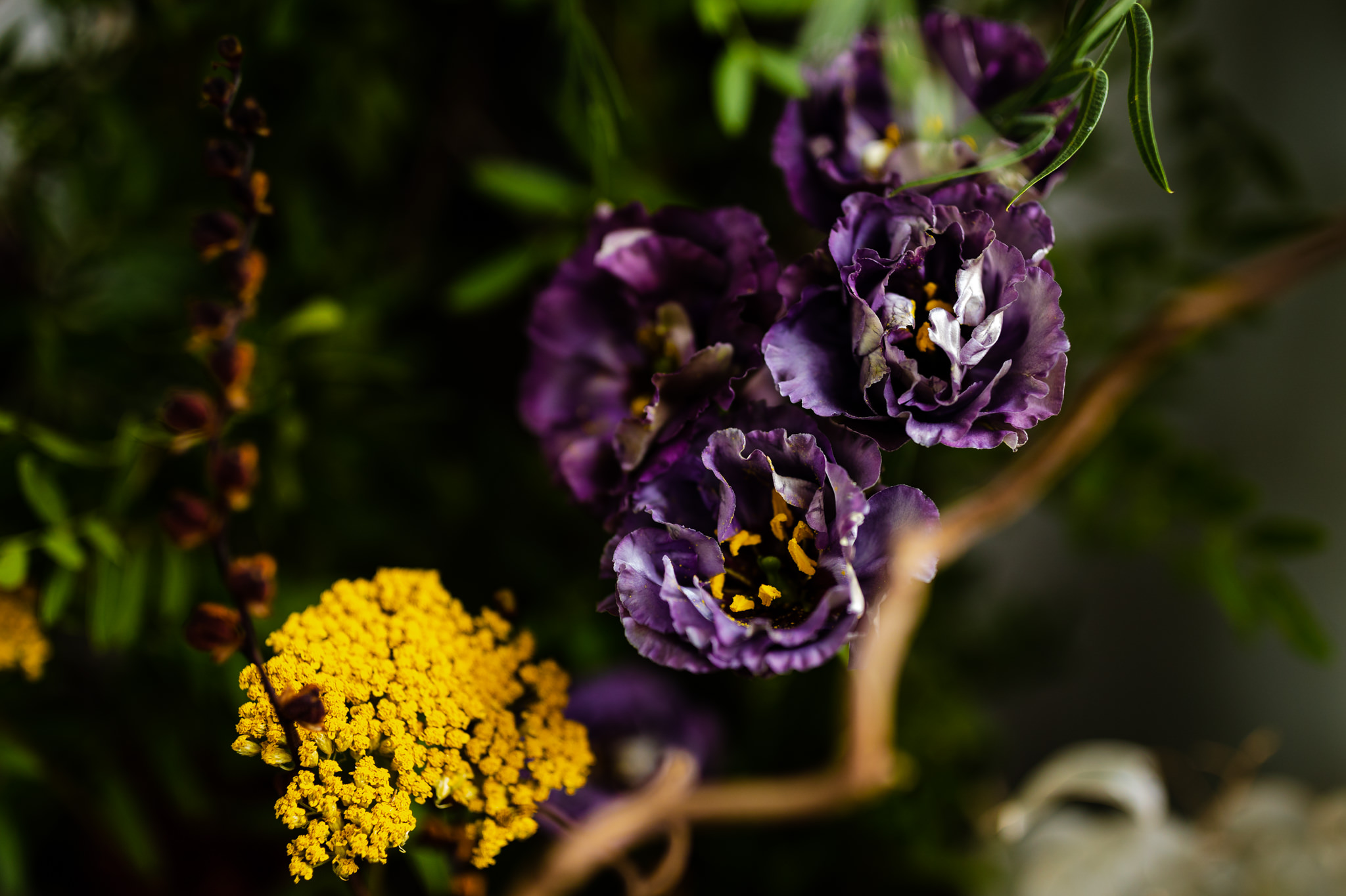 close up of purple and yellow wedding flowers