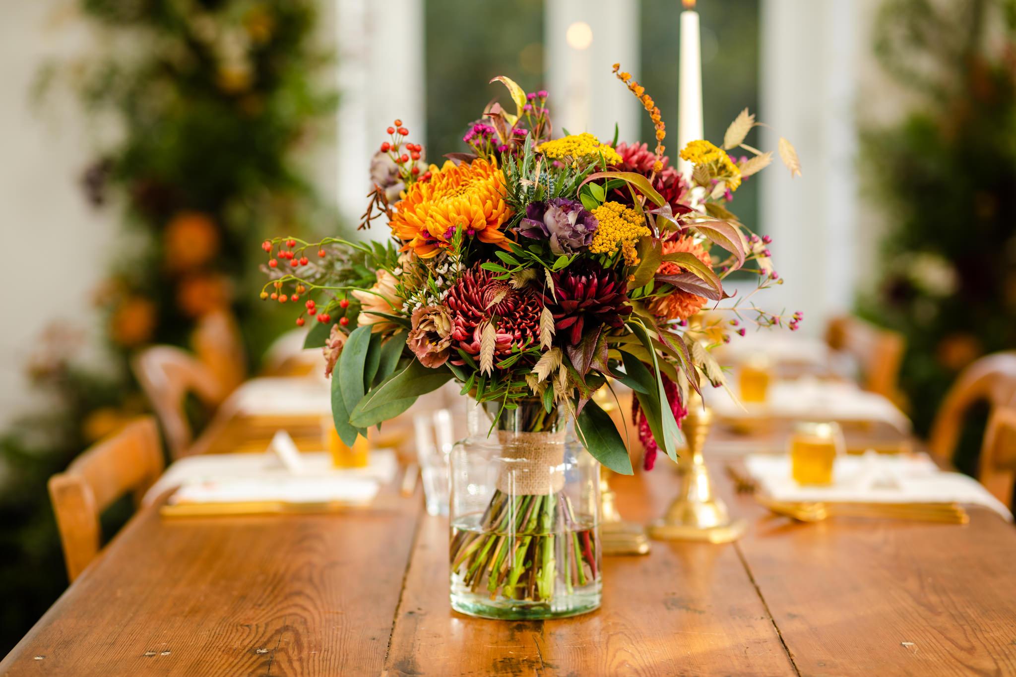 autumn colours bridal bouquet on wooden table