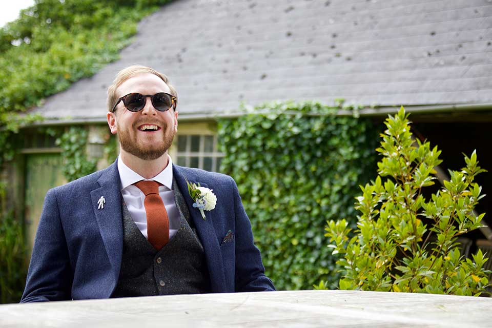 laughing groom wearing sunglasses