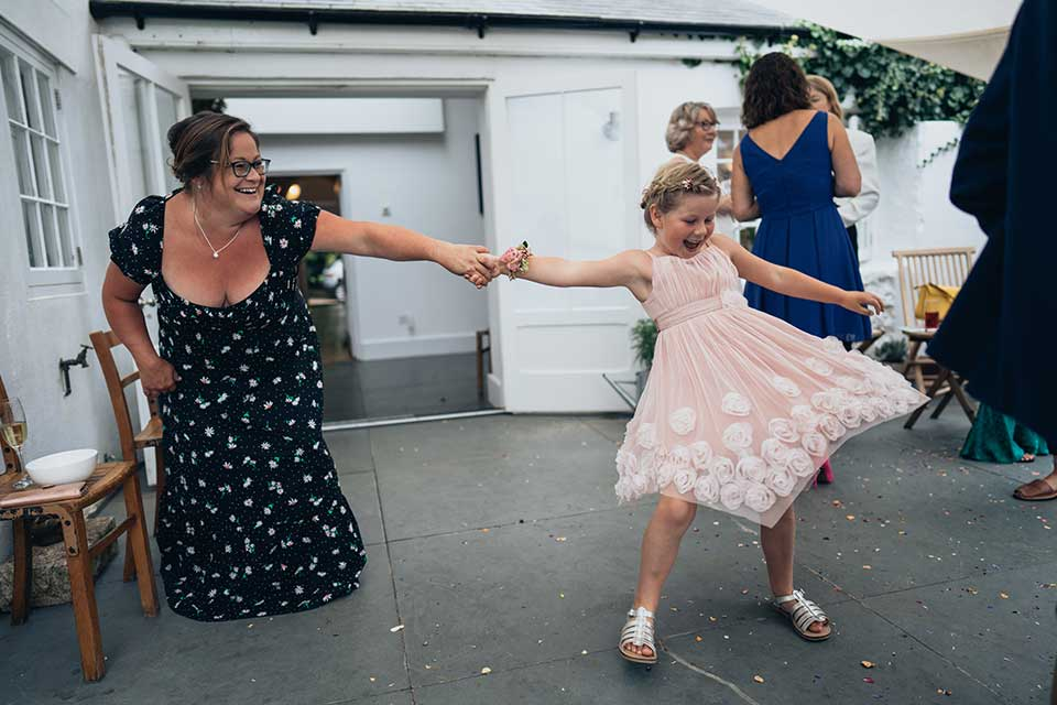 mother and daughter dancing at small wedding
