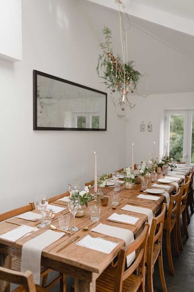 small wedding table setup with white flowers and linen napkins