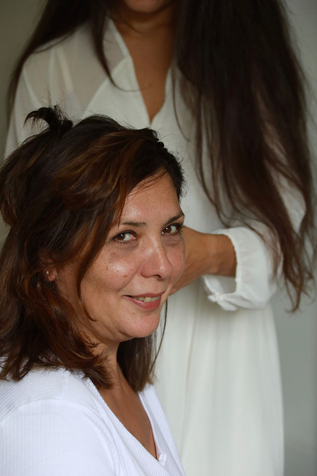 Mother of the bride having her hair done on wedding day