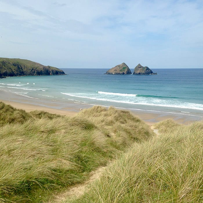 Holywell Bay Cornwall blue sea and sand dunes