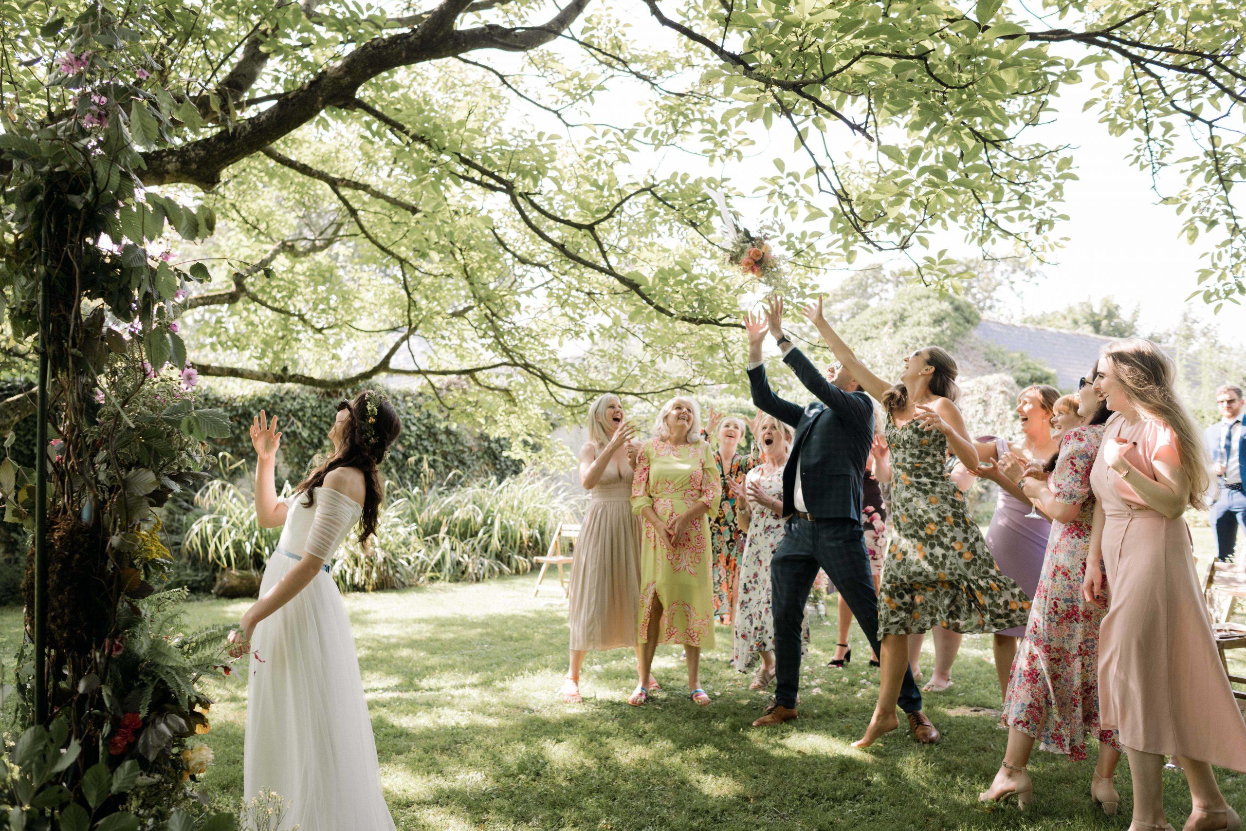 bouquet toss under walnut tree