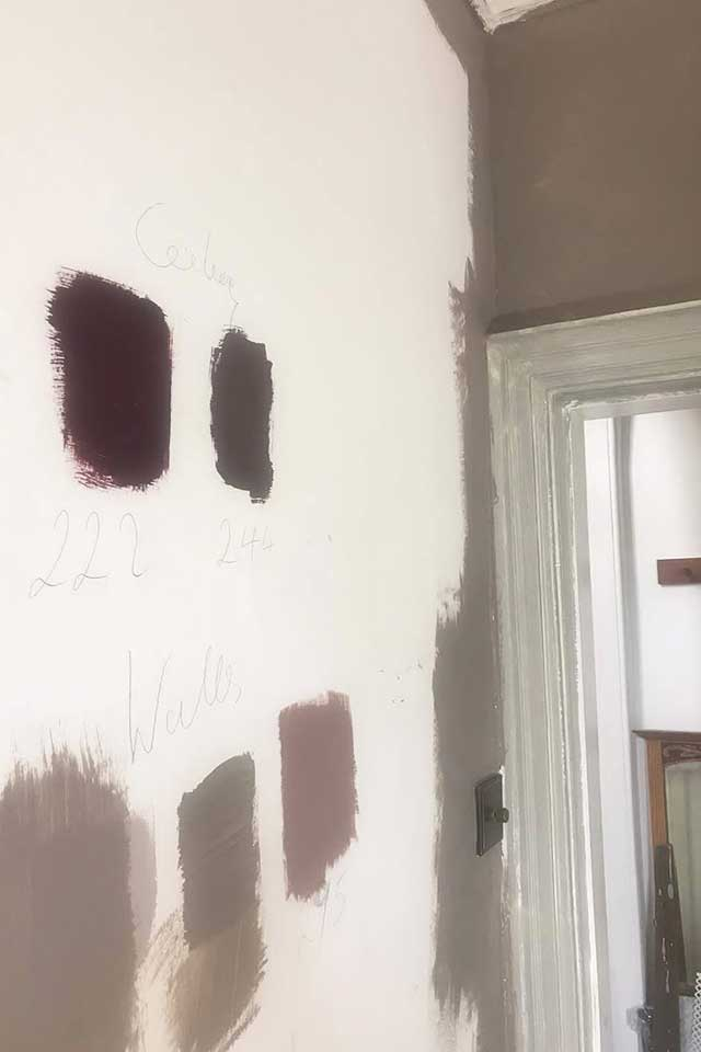 grey and plum Farrow and Ball paint swatches on white wall