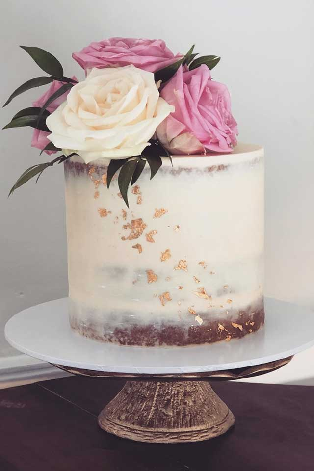 semi naked small wedding cake with gold leaf and fresh roses