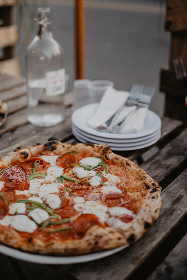 cheese and tomato pizza on wooden table