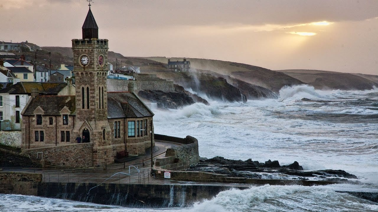 Porthleven clock tower stormy seas crashing waves