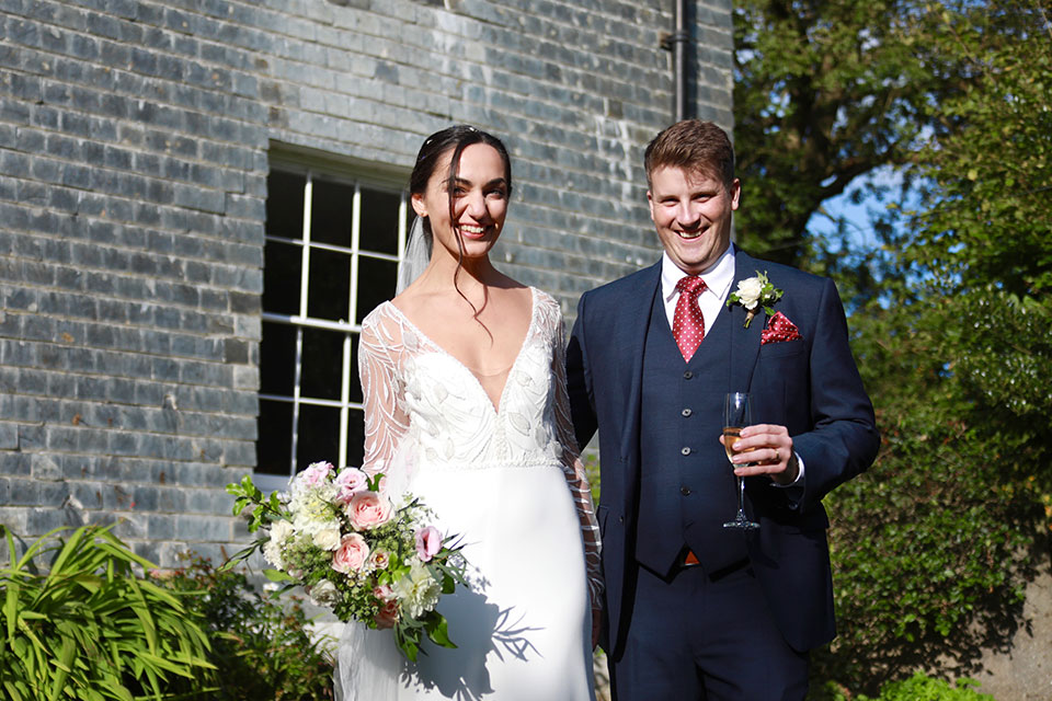 bride and groom smiling at real small wedding in sunshine