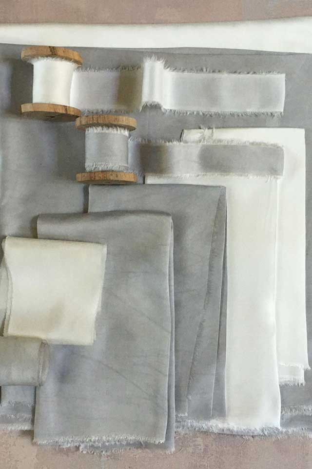 delicate blue and cream hand dyed silk tablecloth and ribbon