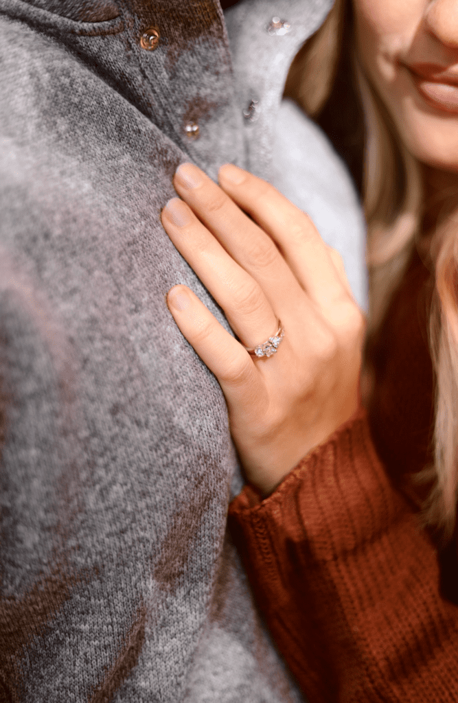 Womans hand wearing silver engagement ring