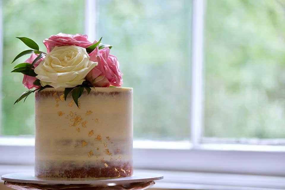 stylish petite wedding cake semi naked with gold leaf