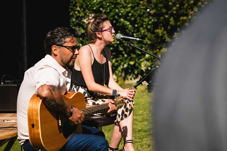 Acoustic duo Scenic Route playing at small wedding