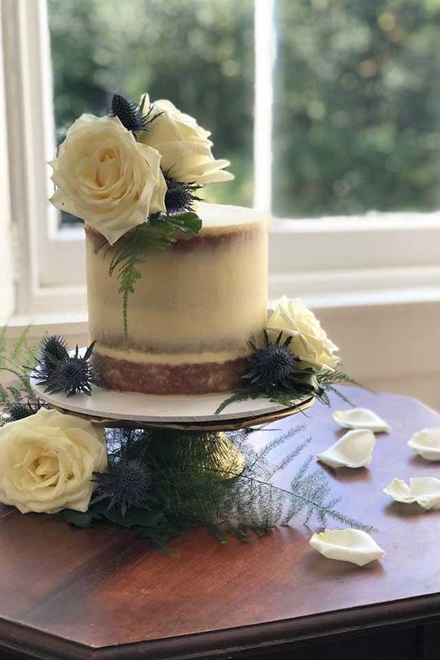 stylish small wedding cake with white roses