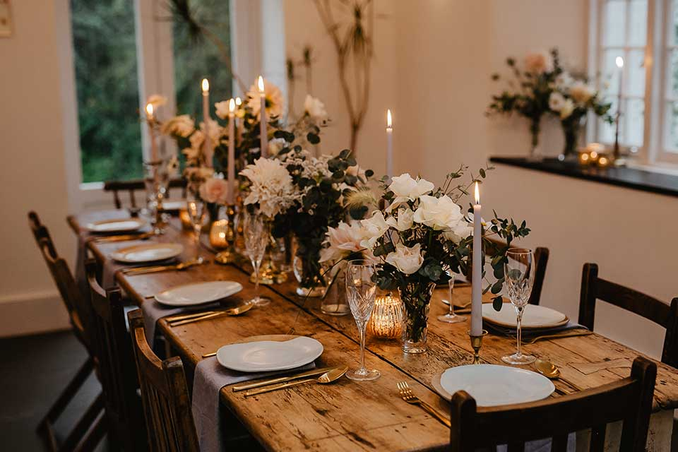 intimate wedding table setting with flowers and candelight