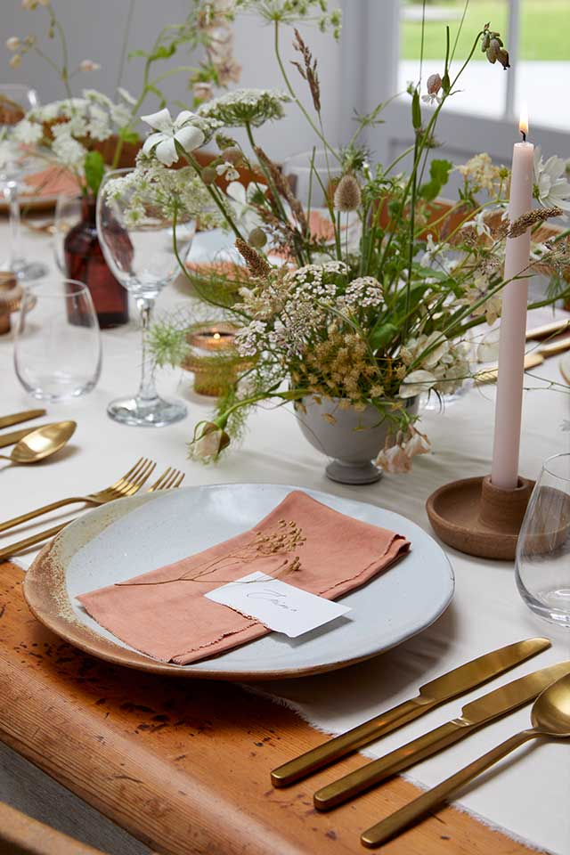 small wedding tablescape with silk napkins and nude candles