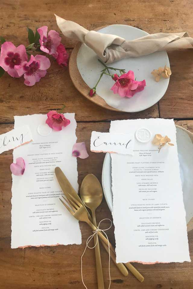 wedding stationery with pink flowers and gold cutlery