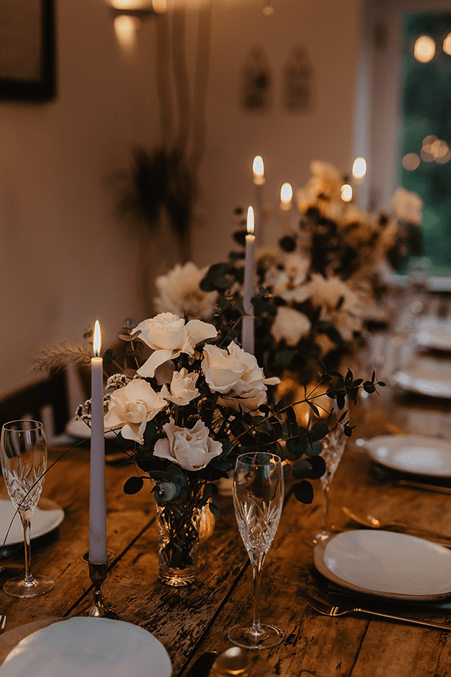 wedding table setting flowers and brass candlesticks
