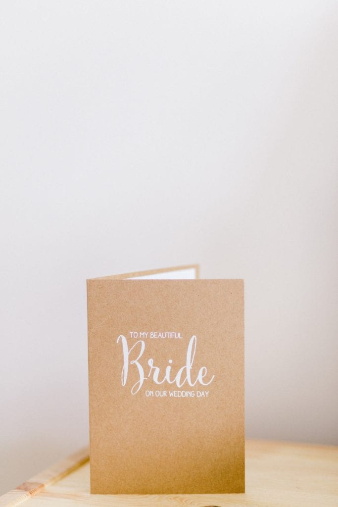 brown kraft card with Bride in white text