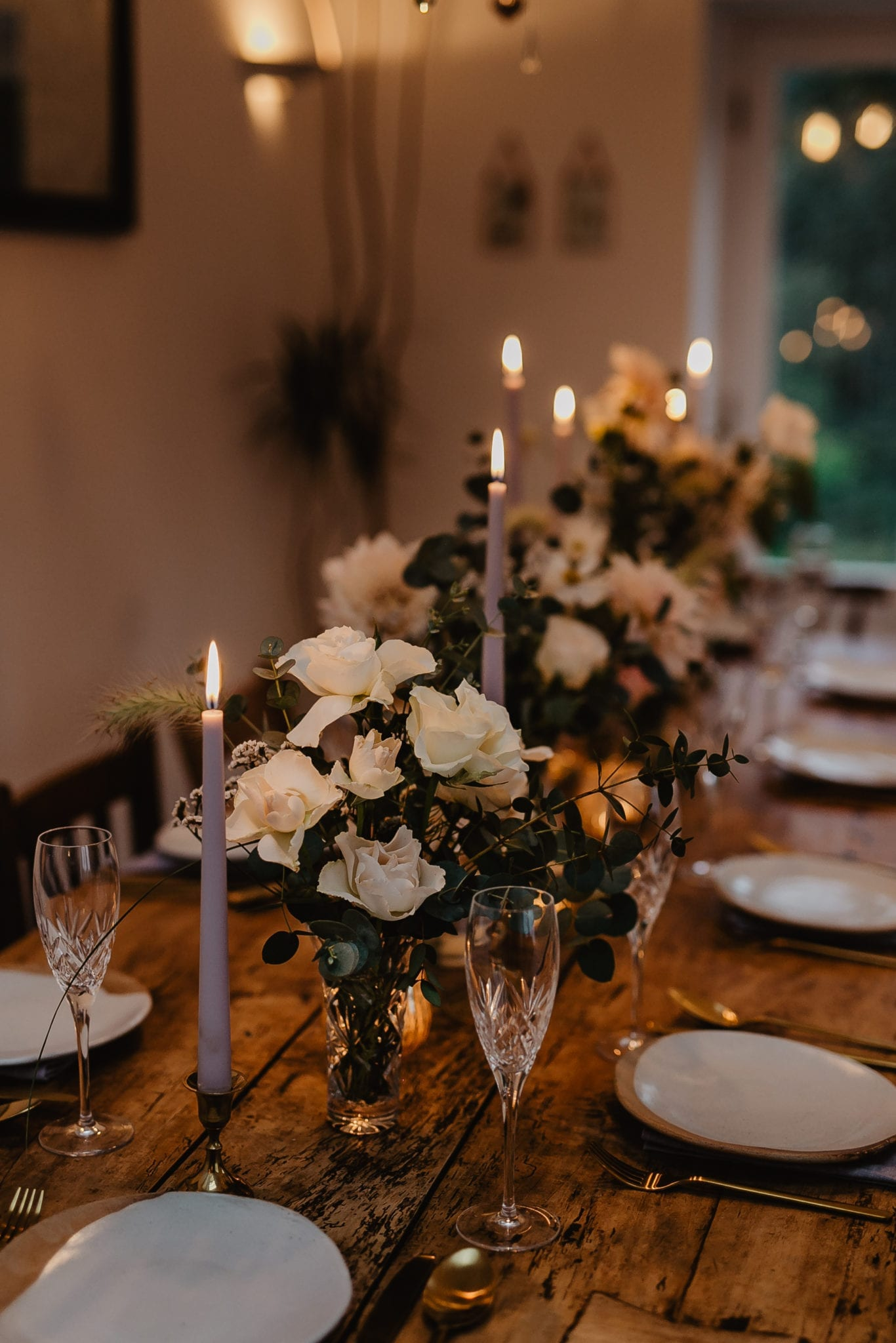 Elegantly styled wedding breakfast table with rustic place settings and country flowers