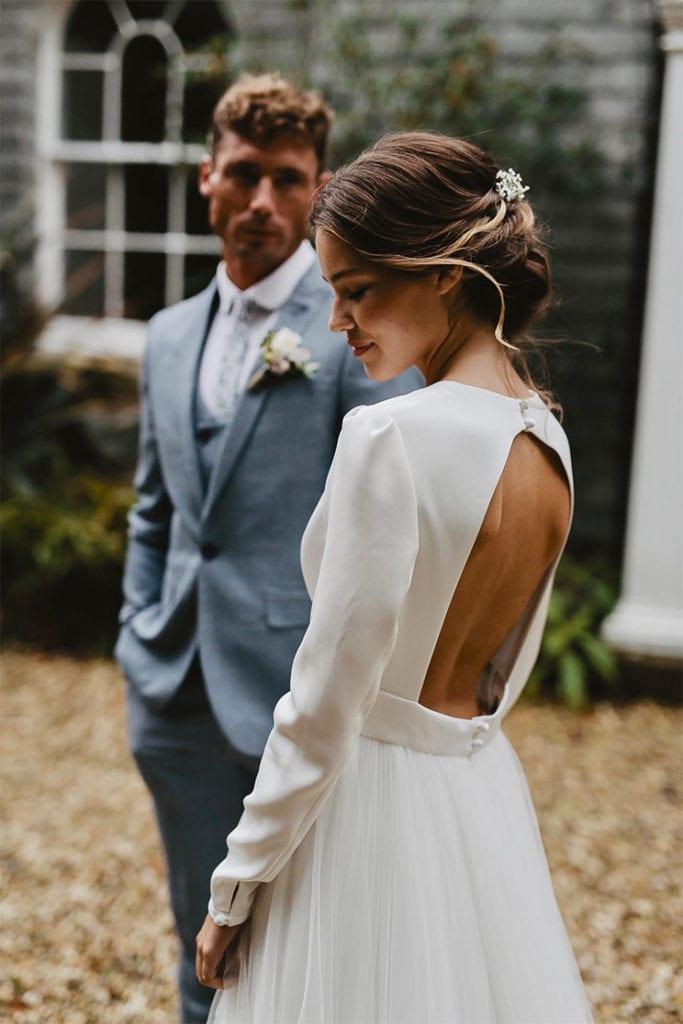 Bride and groom stood outside elegant Georgian wedding venue