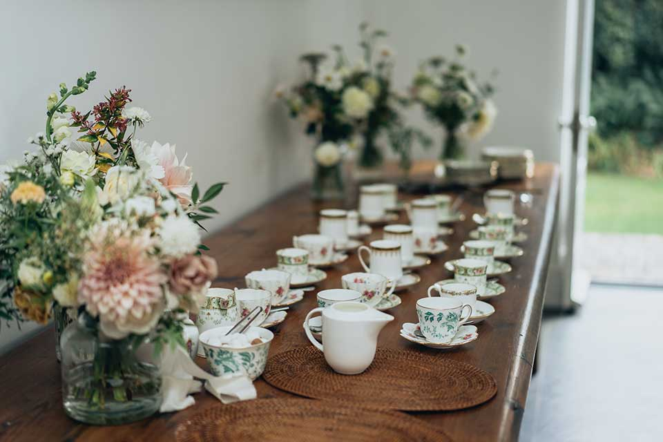 vintage tea set up at micro wedding with flowers
