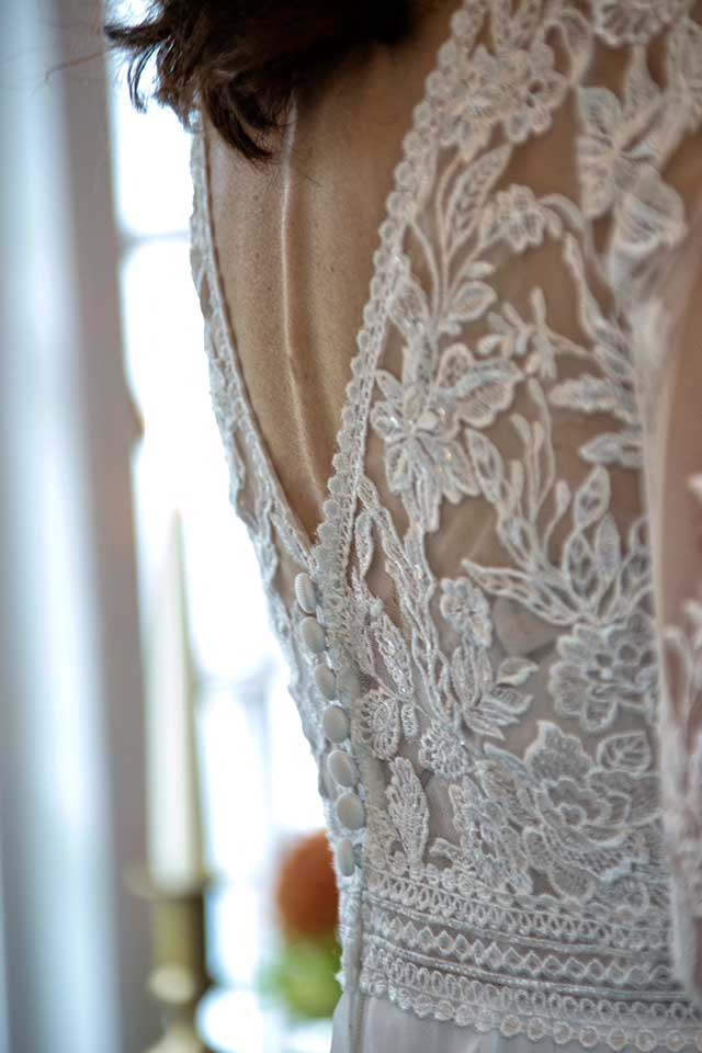 back detail of lace wedding dress with covered buttons