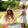 Two mini bridesmaids playing with wooden toys with wedding childcare