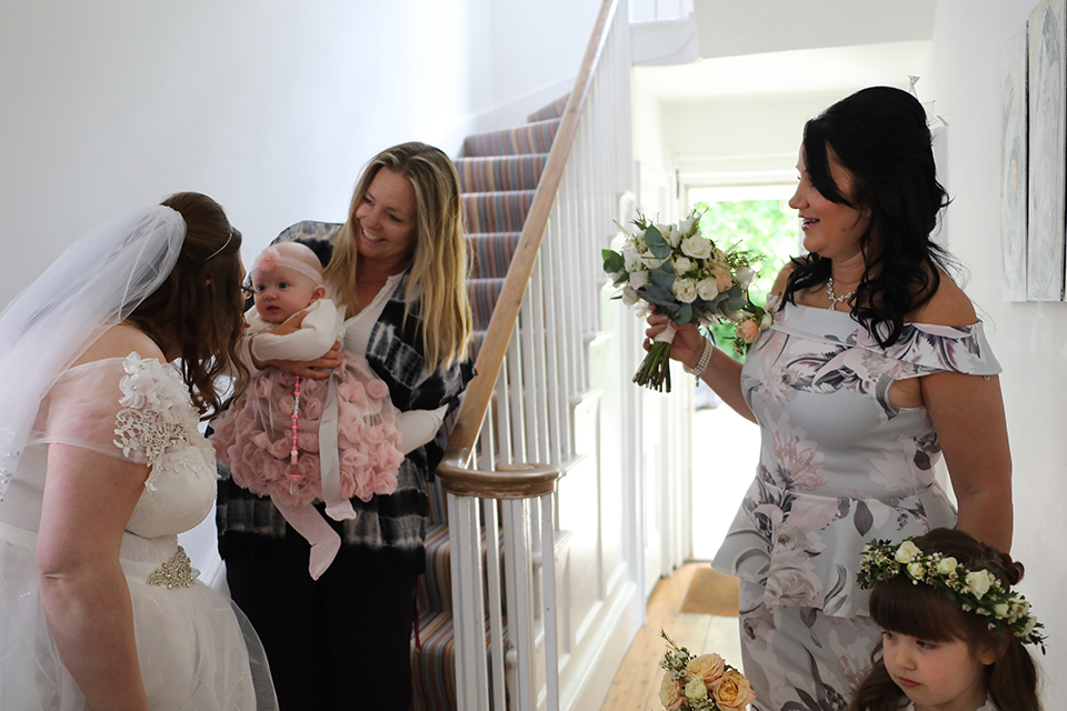 bride and bridal party making their entrance down staircase
