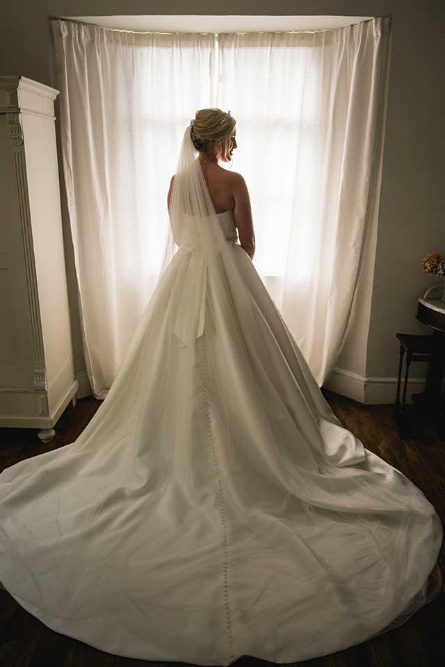 bride wearing white wedding dress big skirt