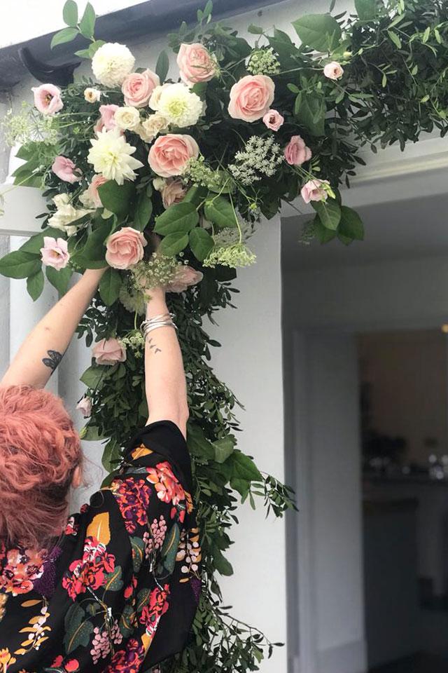 wedding flower arch installation by Tide Flowers