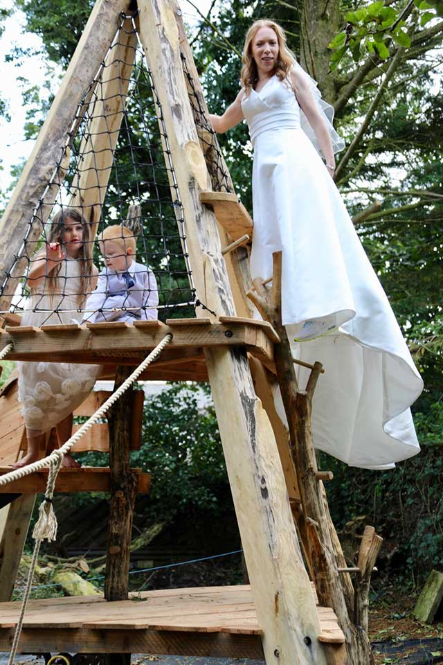 bride on wooden playground fun wedding