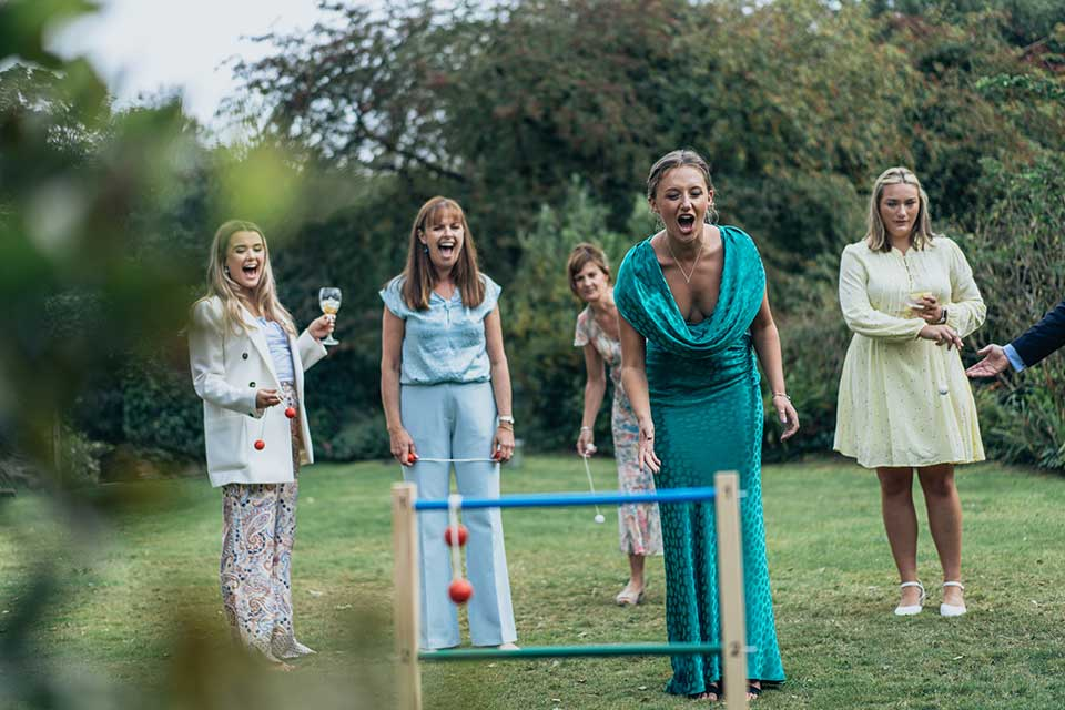 group of girls playing garden games at a small wedding