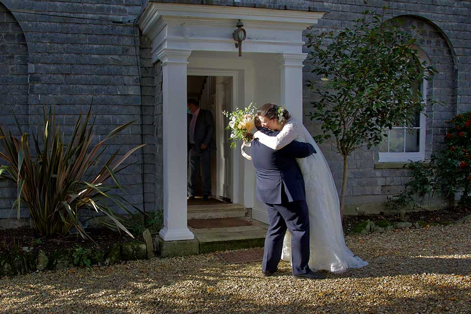 bride and groom hugging at small Georgian wedding venue