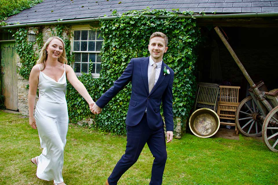 happy just married couple in green sunny garden