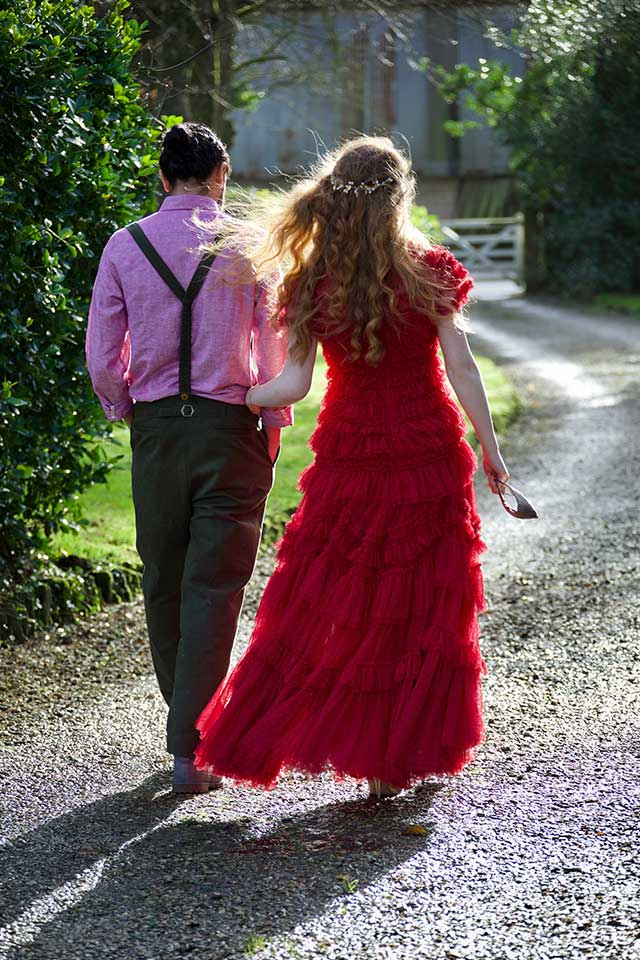 bride in red wedding dress with groom