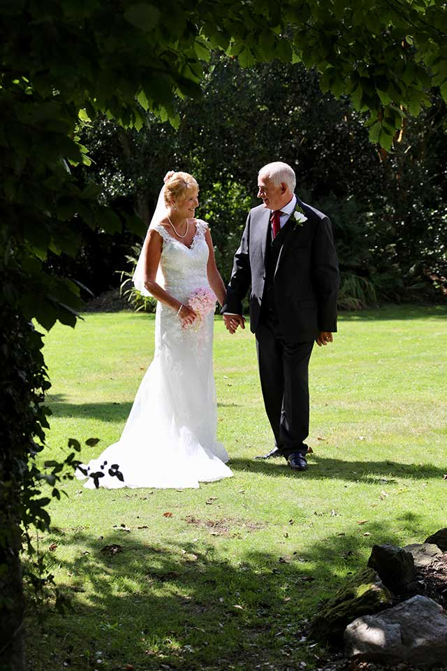 bride and groom in country gardens