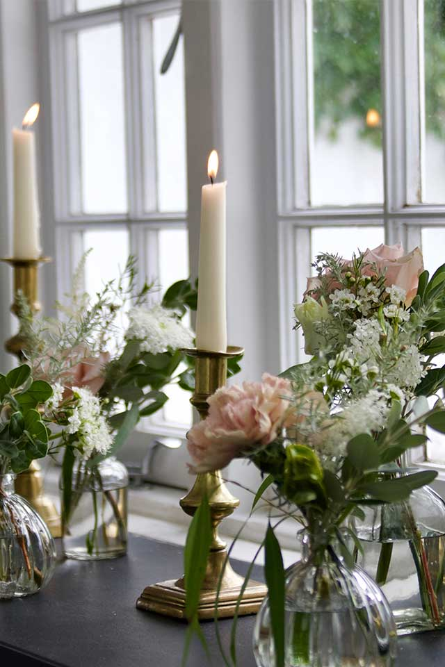 delicate wedding flowers windowsill with candles