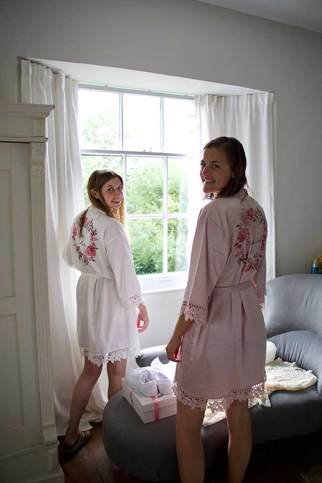 bride and bridesmaid in customised wedding gowns