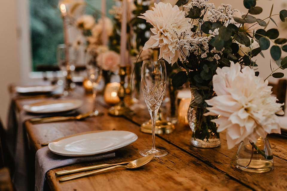 style wedding table with champagne flutes and fresh flowers