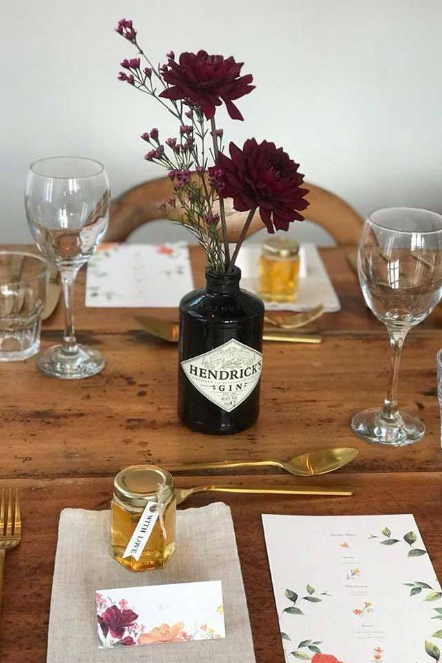 wedding table setting with gin bottles