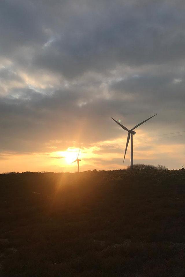 win turbine in Cornwall with sunset