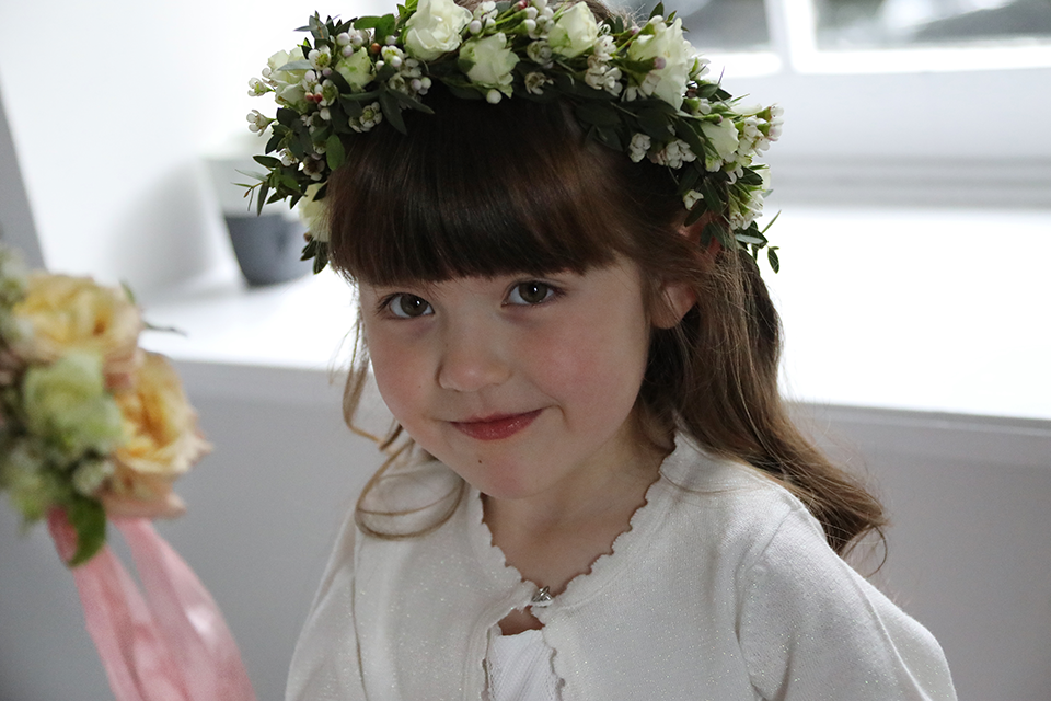 young flower girl with fresh flower headdress